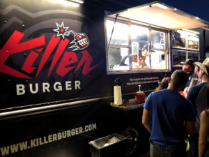 Placing orders at the Killer Burger Food Truck at night